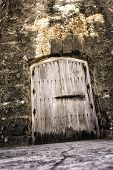 stock photo of dungeon  - Old creepy castle dungeon door and wall - JPG