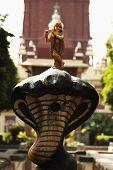pic of lord krishna  - Statue of lord Krishna in a garden - JPG
