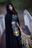 foto of cloak  - girl in a black cloak with a lantern on the bridge - JPG