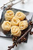 picture of baklava  - Eastern dessert baklava honey with nuts on a plate - JPG