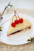 picture of bonaparte  - Napoleon cake with cherries on a plate - JPG