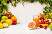 stock photo of vegetables  - Fruit and vegetable borders Fruit and vegetable borders on wood table - JPG