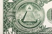 stock photo of illuminati  - The pyramid and eye on the back of a one dollar bill - JPG