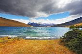stock photo of snow capped mountains  - The gale on the Emerald Lake - JPG