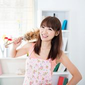stock photo of apron  - Happy Asian housewife with apron housekeeping - JPG
