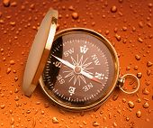 foto of raindrops  - Golden vintage compass opened on raindrop background - JPG