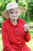 picture of addiction to smoking  - Elderly woman addicted to nicotine and smoking - JPG