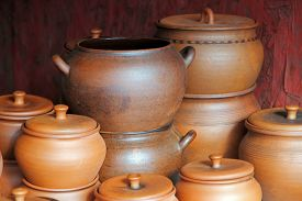 pic of loamy  - Lot of ceramics pots for sale taken closeup - JPG