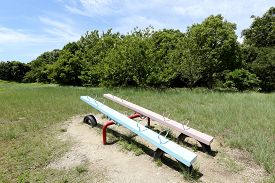 stock photo of seesaw  - Empty seesaw in a park - JPG