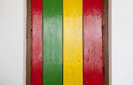 picture of reggae  - Reggae bright colors over wooden door - JPG