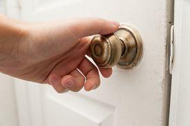 picture of door-handle  - Human hand holding door handle and opening the door close up - JPG