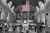 stock photo of amtrak  - Commuters under the Stars and Stripes in Grand Central Terminal - JPG