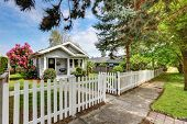 Cute Craftsman Home Exterior With Picket Fence poster