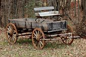 stock photo of wagon wheel  - picture of an Old wagon sitting 