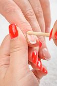 Nail salon, hands beauty treatment, cuticles care with bamboo wood cuticle pusher poster