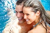 stock photo of hot-tub  - Young loving couple relaxing in the water - JPG