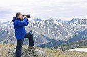 Photographer In Mountains