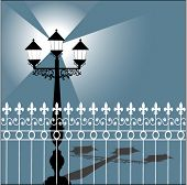 stock photo of lamp post  - lamppost with shadow and fence - JPG