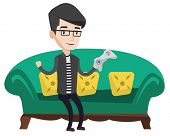 Happy caucasian gamer sitting on a sofa and playing video game. An excited young gamer with console  poster