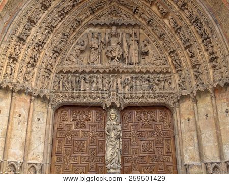 The Tympanum And The Statue
