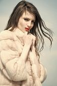 Woman With Long Brunette Hair And Red Lips In Coat. Girl In Fashionable Fur Coat In Winter. Fashion  poster
