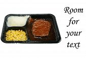 pic of frozen tv dinner  - a delicious and nutricous  classic salisbury steak tv dinner with mashed potatoes and corn in its black plastic tray - JPG
