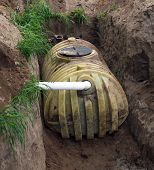 stock photo of septic  - septic tank that is being covered with dirt - JPG