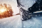 Car Tires On Winter Road Covered With Snow poster