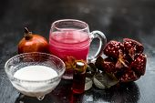 Close Up Of Pomegranate Shrbat Or Juice With Milk,pomegranate Essence,sugar And Raw Pomegranate On W poster