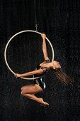 A Young Girl Performs The Acrobatic Elements In The Aerial Ring. Aqua Studio Shooting Performances O poster