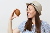 Young Smiling Brunette Woman In Summer Hat Hold In Hands Coconut Or Exotic Coco Nut Isolated On Whit poster