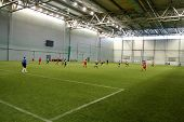 Game of football in indoor hall