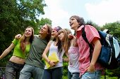 picture of happy kids  - happy young students in park - JPG