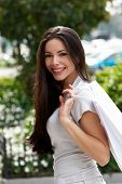 image of beautiful face  - The beautiful young girl with a shopping Bag - JPG