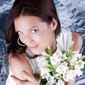 image of good-looker  - Beautiful brunette hold a bouquet white flowers - JPG
