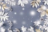 Winter Concept Flat Lay With Golden And Silver Leaves With Snow Falling. Christmas Frame Background poster