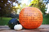 Image of a Thankful Pumpkin holiday craft tradition, thankful words written on a pumpkin poster