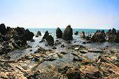 Постер, плакат: Тропический скалистый пляж в Арамболь Гармала Гоа Индия