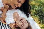 Cropped Beautiful Happy Mother And Her Little Smiling Daughter Outdoors. Cute Mom And Her Child Play poster