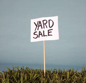 stock photo of yard sale  - yard sale sign in grass - JPG