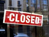 stock photo of showrooms  - Closed sign in a shop showroom with reflections - JPG