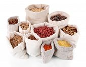 Different kinds of beans in sacks isolated on white