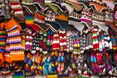 Colorful woolen socks, hats and gloves background