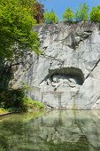 stock photo of shiting  - Dying lion monument in Lucerne  - JPG