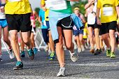 foto of competing  - Marathon running race people competing in fitness and healthy active lifestyle feet on road - JPG
