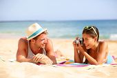 stock photo of beach hat  - Beach fun couple travel - JPG