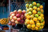 image of indian apple  - Various Indian oranges and apples in bags at the market Kumly Kerala India - JPG