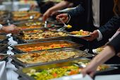 image of catering service  - people group catering buffet food indoor in luxury restaurant with meat colorful fruits  and vegetables - JPG