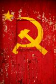 pic of communist symbol  - Communist Party symbol in a old wooden door with red paint peeling - JPG