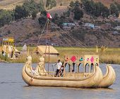 Indians sail by boat.